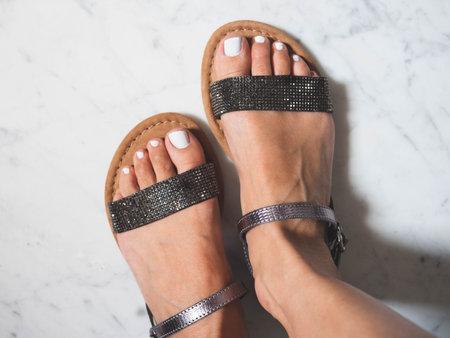 A top view of shiny summer sandals, fashion elegant female footwear Standard-Bild