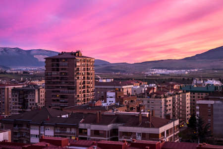 The breathtaking view of a pink sunset and city