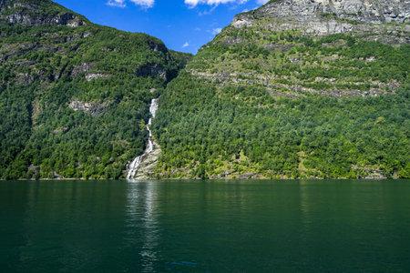 The Seven Sisters waterfall over Geiranger Fjord in Sunnmore More og Romsdal Norway 免版税图像