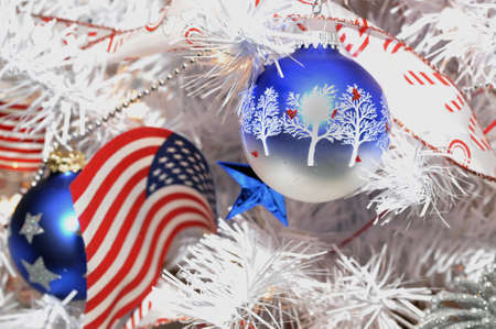 An American Flag Christmas ornament on a white tree Banco de Imagens