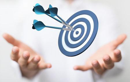 arrow hitting in the target center of dartboard on bullseye