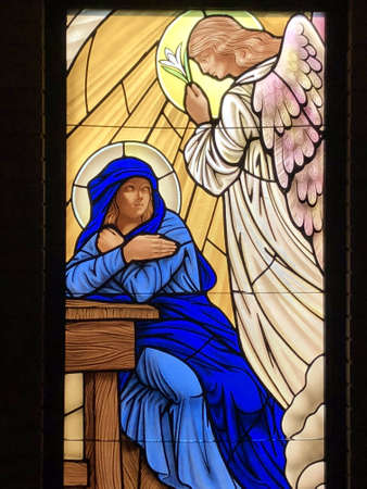 OCEAN SPRINGS, UNITED STATES - Nov 11, 2018: Stained Glass image of the Annunciation taken at St. Elizabeth Seton Catholic Church. 에디토리얼