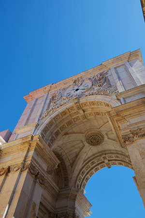 LISBON, PORTUGAL - Jun 11, 2019: Low angle shot of the Arco da Rua Augusta in lisbon portugal with a bright blue sky during a very hot day