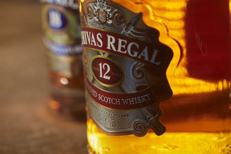 SAO PAULO, BRAZIL - Jan 01, 2020: Close-up in a bottle of Chivas Regal 12yo, with Chivas 18yo at the blurred background.