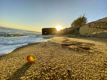 A wide angle shot from the sunset in Mataró with an old Civil War bunker in the background placed on the beach. Banque d'images