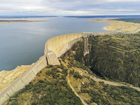 An aerial shot of the Almendro dam in Salamanca, Spain Reklamní fotografie