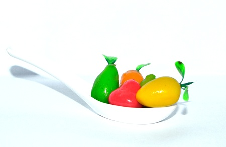 thai dessert Lookchoup in spoon with white background Stock Photo