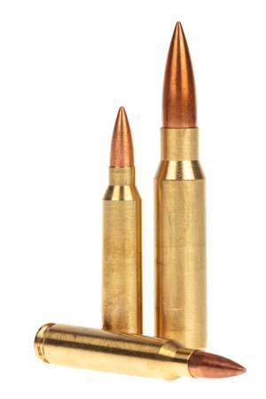 Three rifle bullets over white background Stock Photo