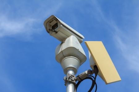 CCTV with microwave transmitter under blue sky photo
