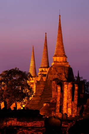 thailand s landmarks: Pagoda at wat phra sri sanphet temple at twilight, Ayutthaya, Thailand Stock Photo