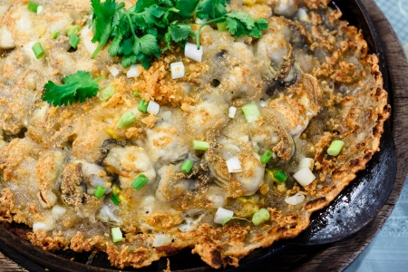 Crisp fried oyster pancake in hot plate photo