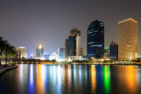 Modern business area at night in Bangkok, Thailand photo