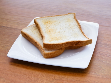 A pair of toasts in a plate on a table photo