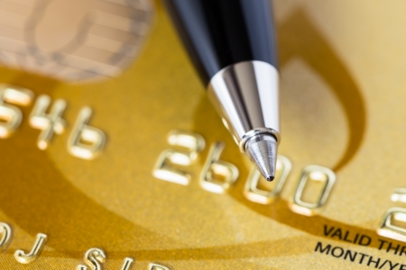 bankcard: Pen on gold credit card