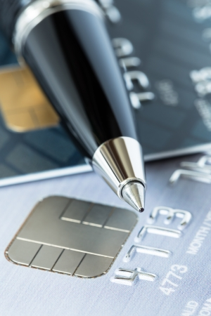 bankcard: Pen on credit stack of cards Stock Photo
