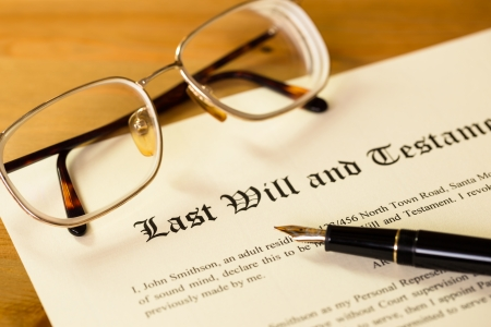 financial official: Last will and testament with pen and glasses concept for legal document