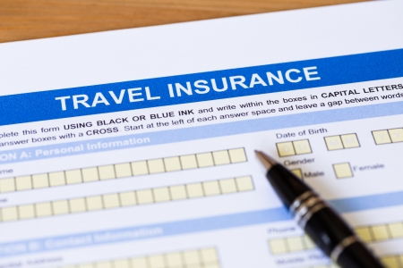 Travel insurance application form with pen concept for travel planning