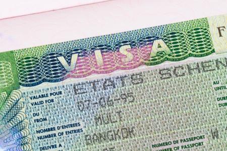 immigrate: Schengen visa in passport macro