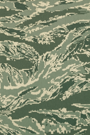 Green digital tigerstripe camouflage fabric texture background photo