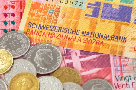 franc: Switzerland money swiss franc banknote and coins close-up