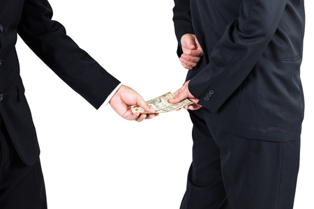 bribery: Businessman receive money by his back concept for corruption Stock Photo