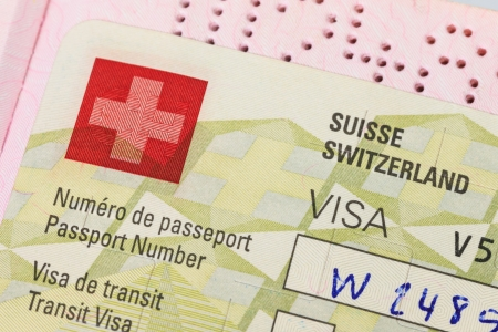 Switzerland visa in passport macro photo