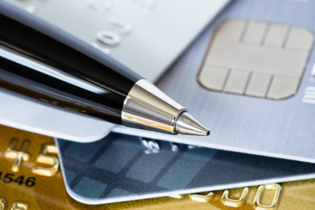 Pen on credit stack of cards photo