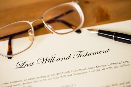inherit: Last will and testament with pen and glasses concept for legal document