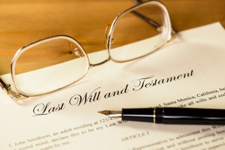 Last will and testament with pen and glasses concept for legal document photo