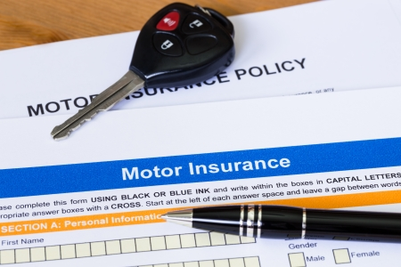 car insurance: Motor or car insurance application with pen and car key