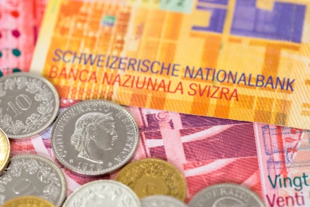 Switzerland money swiss franc banknote and coins close-up  focus on coin