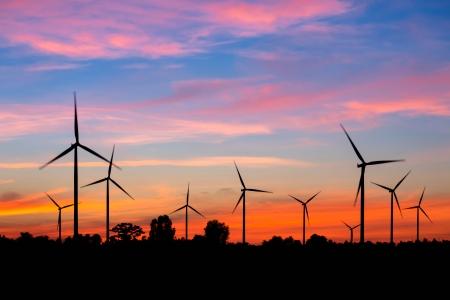 Wind turbine power generator at twilight Stock Photo