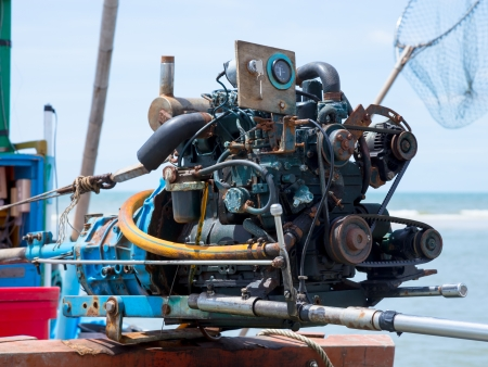 Old fishing boat engine photo