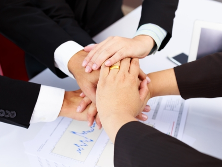 Businesspeople join hands concept working together or teamwork photo