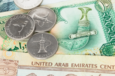 United Arub Emirates banknote and coins close-up photo