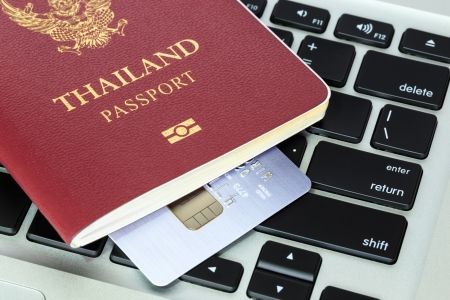 e ticket: Passport and credit card on keyboard concept electronic online booking
