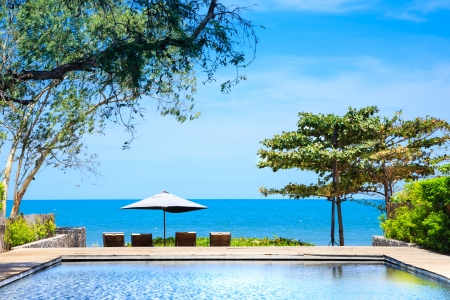 Beach side swimming pool at resort Thailand photo