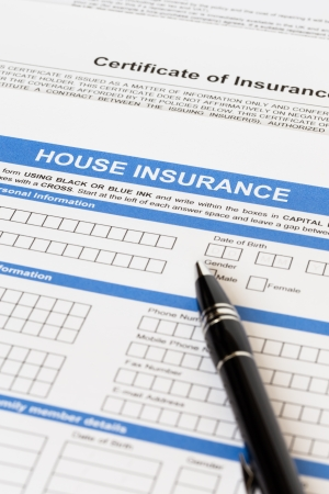 House insurance application with pen photo