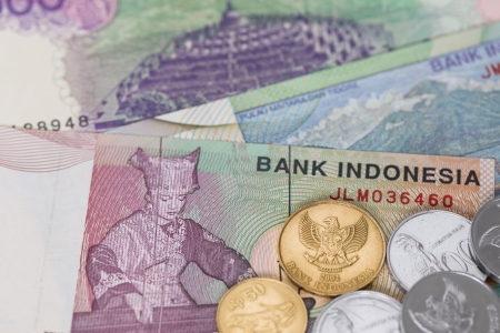 Indonesian money rupiah banknote and coins close-up photo