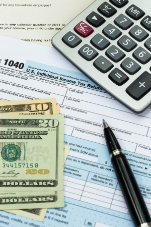 tax return: Tax form with pen, calculator, and dollar banknote taxation concept Stock Photo