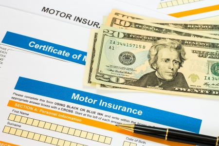 Motor or car insurance application with banknote and pen photo