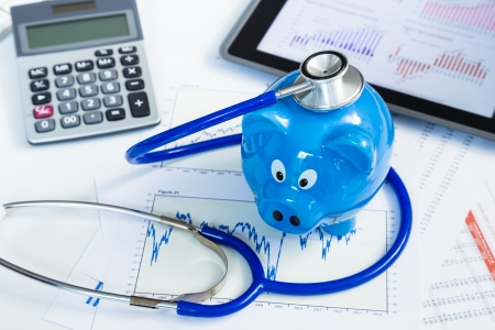healthy economy: Stethoscope and piggy bank for health insurance concept