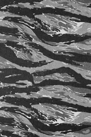 Urban tigerstripe camouflage fabric texture background Stock Photo