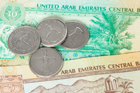 ajman: United Arub Emirates banknote and coins close-up