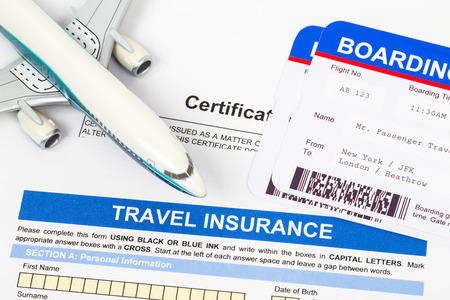 ticket office: Travel insurance application form with plane model and boarding pass