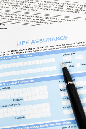 Life assurance application form with pen concept for life planning photo