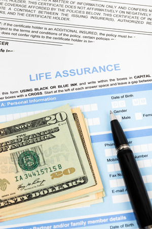 Life assurance application form with pen and banknote concept for life planning photo