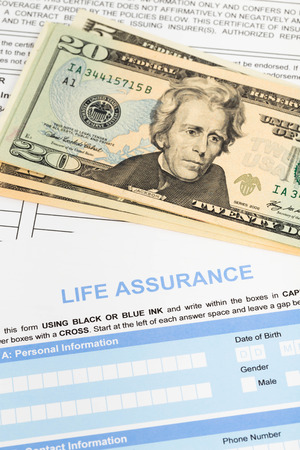 Life assurance application form with banknote concept for life planning photo