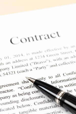 Business contract document focus on pen Stock Photo