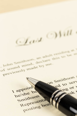 Last will on cream color paper focus at pen concept for legal document photo